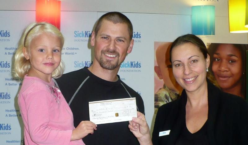 Chris Beatty presents cheque to Sick Kids\' Hospital